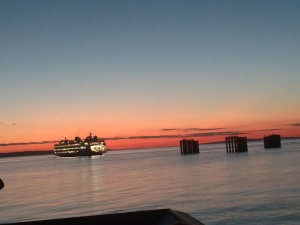 A ferry boat on the Puget sound at sunset