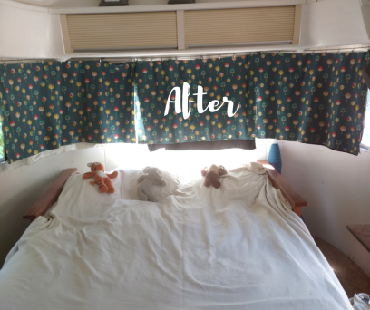 After photo of bed in 1974 Airstream Argosy after remodel. Organic cotton curtains with colorful trees, Amish designed futon in cherry wood with organic cotton and wool mattress, cream organic sheets and organic stuffed animals on the bed.