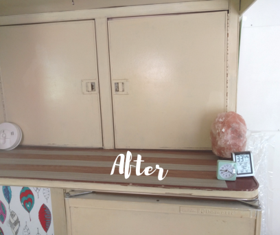 After photo of kitchen counter of 1974 Airstream Argosy before remodeling. Contains all the original Airstream parts. Painted with cream Milk Paint, Marmolem wood-grain strips on counter, pink salt lamp, clock and humidity monitor pictured as well as leaf coloring wallpaper.