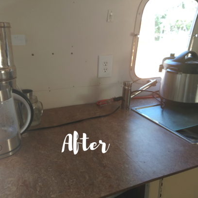 After photo of kitchen of 1974 Airstream Argosy following remodel. Shitake Marmoleum countertop with IKEA sink, tempered glass cutting board, InstantPot, Berkey Water Filter and Electric kettle