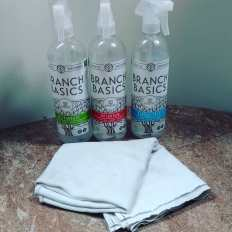 Branch Basics Cleaning bottles with a flat diaper for cleaning cloth